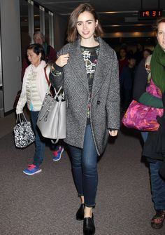 Lily Collins rocking a boyfriend coat like a total pro http://www.cosmopolitan.co.uk/fashion/celebrity/news/a31607/oh-hey-lily-collins-channeling-wondrous-winter-vibes/