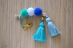 Tassel keychain Pom pom bag charm Purse charm Pom pom handbag charm Pom pom key chain Hot pink tassel key ring Tassel clip Seashell keychain Colorful bag charm / keychain made of hand crafted pom poms and tassels. One size. Length: approx. 7.8 inches / 20 cm ♥ Heartmade item ♥ All my products come in a nicely crafted wrapping, so they are ready to be given as gifts. Every piece of jewelry is made in a smoke and pet free environment. Orders will be mailed by registered and insu...