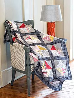 """Diamond District is an easy way to showcase a collection of 5"""" charm squares and easy piecing half-square triangles makes this quilt come together quickly. For a quilting tutorial on how to make this quilt, visit FonsandPorter.com/DiamondDistrict."""