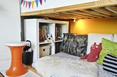 white IKEA Expedit bookcase used in kids' reading den under the KURA loft bed