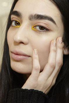 yellow eyeliner.
