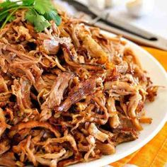 (Mexican Slow Cooker Pulled Pork) Pile of golden, crispy and juicy Pork Carnitas on a white plate.Pile of golden, crispy and juicy Pork Carnitas on a white plate. Slow Cooking, Slow Cooked Meals, Slow Cooker Pork, Slow Cooker Recipes, Cooking Recipes, Kitchen Recipes, Salsa Ranchera, Salsa Picante, Pulled Pork Recipes