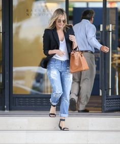 I've always felt that at the heart of every woman's wardrobe is a great pair of jeans and a crisp white tee. The pieces can be styled in any way and fit into every budget. Molly Sims rocks the two p...
