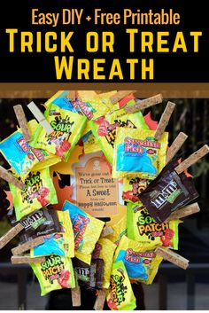 This DIY Trick or Treat Halloween Candy Wreath and a fun and simple way to leave candy for Trick or Treaters when you're not home!