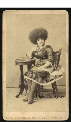 1800s CDV Photo of a Black Sideshow Woman with Huge Afro. $109.00, via Etsy.