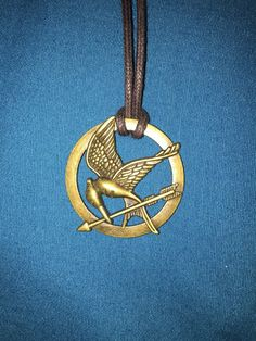 Hunger Games Mocking Jay Necklace by RainBowCoveStyles on Etsy https://www.etsy.com/listing/255891098/hunger-games-mocking-jay-necklace