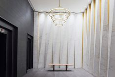 New York studio GRT Architects has repaired the decorative facade of a tower in the city's Garment District, during the renovation of its entrance. Lobby Interior, Interior Design, Interior Walls, Elevator Lobby, Tower Building, Lamp Design, Facade, The Help, Restoration