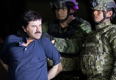 "FILE - In this Jan. 8, 2016 file photo, a handcuffed Joaquin ""El Chapo"" Guzman is made to face the press as he is escorted to a helicopter by Mexican soldiers and marines at a federal hangar in Mexico City. According to Mexico's Foreign Ministry, Guzman has been extradited to the United States on Thursday, Jan. 19 2017.  (AP Photo/Eduardo Verdugo, File)"