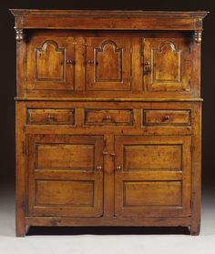 A CWPWRDD DEUDDARN,  QUEEN ANNE, EARLY 18TH CENTURY, WALES  oak, the lower cupboard with a shelf