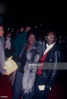 Miles Davis with his girlfriend Cicely Tyson. He is wearing a leather jacket and white glases she has a fur; circa New York. Get premium, high resolution news photos at Getty Images Miles Davis, I Wanna Party, Jazz, Black Actresses, Famous Black, African American History, Celebs, Celebrities, Couple Shoot