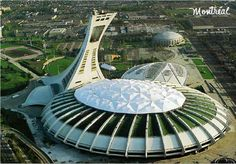 In 1976 the Olympic games were held in Montreal, Canada. This affected Canadians because it was a major moral booster. The games got people's minds off what was happening in Europe and they made people happy. Also in 1988 the games were held in Calgary. Olympic Stadium Montreal, The Neverending Story, Water Signs, Famous Buildings, Futuristic City, World's Fair, Nature Images, Deconstruction, Olympic Games