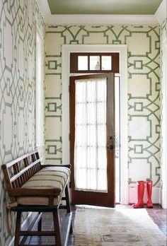 a bold stencil design in a cheerful green brings color to the room without being overwhelming