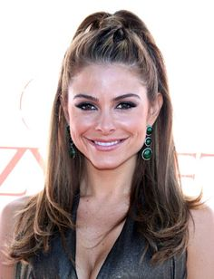 Play with the high pony trend, like Maria Menounos, by pulling half of your strands up and holding in place with an elastic.