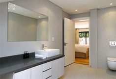 Casablanca in Camps Bay, en suite bathroom Modern Lounge, Apartment, Lighted Bathroom Mirror, Luxurious Bedrooms, Spacious Living, Luxury Apartments, Rental Apartments, Holiday Apartments, Bathroom