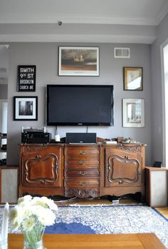 Today, many people hang their TV & art over versatile antique sideboards for an attractive & practical eclectic mix of old with new. #French_antique_sideboard #decorating_with_antiques
