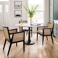 Inspired by those found in Parisian cafés, our Rae Round Marble Pedestal Dining Table features a decorative metal base and polished marble top. It's ideal for a cozy meal in a breakfast nook or for creating a stylish dining spot Marble Top Dining Table, Marble End Tables, Round Pedestal Dining Table, Black Round Dining Table, Dinning Table, Dining Set, Retro Dining Chairs, Dining Arm Chair, Mixed Dining Chairs
