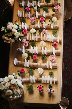 Escort cards were displayed in slated birch tree branches among pink and white roses.