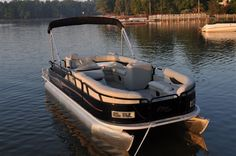 New 2012 Bentley Pontoon Boats 203 Cruise Pontoon Elite - Black Metal and Tan Seating.