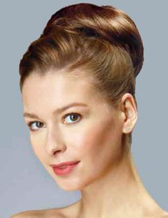 Ballerina Bun Hairpiece by Revlon. Sophisticated chignon, comb or tease for trendy top knot or sleek bun. An affordable and quick solution, this elegant hair addition is ideal for that formal event or dance.