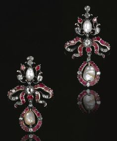 COLLECTION OF PEARL, RUBY, EMERALD AND DIAMOND JEWELLERY , 18TH CENTURY. Comprising: a brooch designed as a warrior, set with rubies, emeralds and diamonds, his breastplate a blister pearl, holding a pearl in one hand; a pair of baroque pearl earrings set with mixed-cut rubies and diamonds and an enamel brooch designed as a stylised bouquet of flowers set with mixed-cut rubies and diamonds.