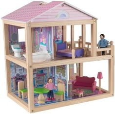 """KidKraft My Pretty Petal Dollhouse by KidKraft. $70.39. Open design and layout means it can be played with from all sides. Lightweight structure makes it easier for mom and dad to move from room to room than larger dollhouses. Includes 9 pieces of furniture and 2 5"""" mini dolls. From the Manufacturer                It's time to let our imaginations run wild and play house. Young girls will absolutely love playing with this gorgeous wooden dollhouse. 11 colorful accessory ..."""