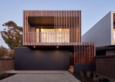 Photo 10 of 16 in McCrae House 1 & 2 by Vibe Design Group - Dwell Garage Exterior, Exterior House Colors, Modern Exterior, Japanese Modern House, Modern Garage Doors, Timber Battens, Metal Facade, Luxury Garage, Facade Design