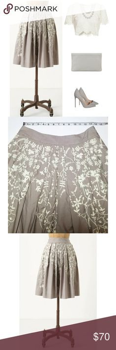 """New! Anthropologie Grey Embroidered Skirt 100% Cotton. Waist measurement is shown, length is approx 24"""". Grey with white embroidery. Pleated A-line silhouette. Called the Hanging Wisteria skirt. Perfect cotton skirt for spring and summer! Excellent condition. From Anthro: Bright white petal-and-vine embroidery spills from the waist of Meadow Rue's crisply pleated poplin skirt.     *I'm lucky that my buyers have all been amazing, but I video record all purchases before & during packaging…"""