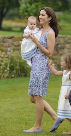 Crown Princess Mary of Denmark (C) and Princess Isabella (R) and Princess Josephine Sophia Ivalo Mathilda (L) attend a photocall at Grasten Castle on August 1, 2011 in Grasten, Denmark.