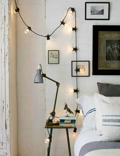 The Ultimate Guide To Lighting Your Bedroom | Use fairy lights to provide ambient mood lighting. In this instance, they help spread light across the wall in areas where task lighting doesn't reach. #lighting #bedroom #fairlights #bedroomdecor #homedecor #bedroomideas #interiors #interiorinspo