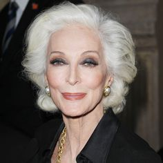 Supermodel Carmen Dell'Orefice shows us how to enhance eyes without looking overdone, with sheer washes of contrasting neutral shades like smoky gray and tan.