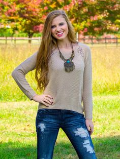Heart of Gold Sweater. The Heart of Gold Sweater is going to be your favorite fall sweater! It is perfect paired with you favorite statement necklace and booties.  The back of this sweater has a fun knit pattern to keep it interesting.