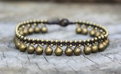 This anklet made with 8mm brass bells and 3mm brass beads woven together with dark brown wax cord and brass bell for closure.    * Length is approx. 10