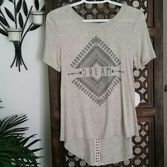 """Moonchild Dream Tee High Low with Crochet Back Cute high low tee with embellishment and crochet detail. Length of front 22.5"""". NWT Non smoking home. moonchild Tops Tees - Short Sleeve"""