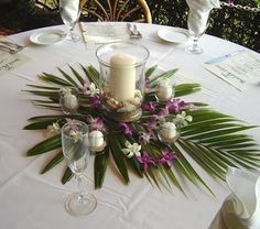 A few coral flowers with the white flowers (no purple). Instead of big candle in the middle, limes in water with flowers on top