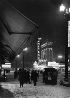 Chicagoans enjoy a wintry night on State Street in 1942 by the Chicago Theatre, just south of Randolph Street. Looking for more holiday magic? Join us for ChicaGlow To purchase a copy E-mail. Chicago History Museum, Liverpool History, Theater, Visit Chicago, Chicago Photos, State Street, Chicago Illinois, Decatur Illinois, Black And White