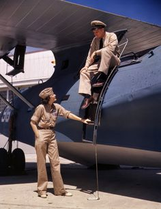 "August 1942. Corpus Christi, Texas. ""Mrs. Eloise J. Ellis, senior supervisor in the Assembly and Repairs Department of the Naval Air Base, talking with one of the men."" 4x5 Kodachrome transparency by Howard Hollem."