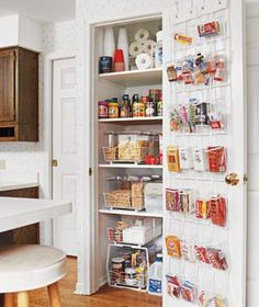 Turning a closet into a pantry? It's a very simple idea. Just put in the movable shelving . Add the shoe organizer on the door for a lot more storage of snacks and small items. The plastic is clear so you will be able to find something at a moment's notice and think about all the space you've created on the shelves.