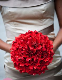 Wedding Ideas : DIY Wedding Bouquet With Origami Paper! It looks like they used some red riboon or strips of red paper between the flowers