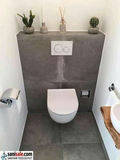 Toilet room with ceramic tiles in concrete look and fountain with wooden washbas. Toilet room with Small Toilet Design, Small Toilet Room, Guest Toilet, New Toilet, Bathroom Design Small, Bathroom Interior Design, Cloakroom Toilet Small, Restaurant Bad, Restaurant Bathroom