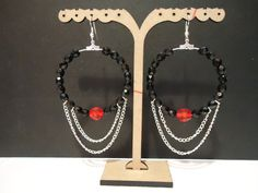 Hoop earrings with black-red glass beads and chains hanging