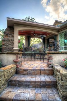 Covered brick, natural stone, and stucco patio