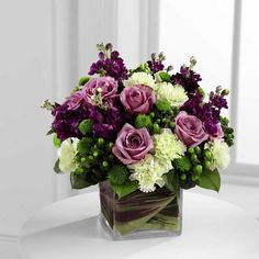 The Beloved Bouquet is a compact arrangement of green and purple flowers designed in a leaf lined square vase hand delivered by a local flower shop. Wedding Flower Arrangements, Wedding Bouquets, Floral Arrangements, Flower Bouquets, Table Arrangements, Wood Flower Box, Flower Boxes, Purple Wedding Flowers, Floral Wedding