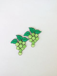 Embroidered green grape iron on patch - Approximate size : 1 1/4 wide x 1 1/4 tall (3 cm. x 3.2 cm.) - Quantity : 2 pieces in green as picture - The way to attach it on your required object :  1. To spray a little bit water on the back of patch.  2. To place the patch on the required position of your garment.  3. To cover the patch with a piece of damp fabric and iron on it for 10-20 seconds. Also iron on the reverse side of the garment (patch position).
