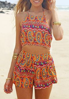 This paisley print halter romper features a halter neckline with adjustable tie at neck and back. It also has an elastic waistline at the back and zipper closure for easy adjustment. | Lookbook Store Jumpsuits and Rompers