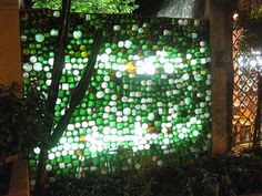 Inside view of recycled glass bottle wall. Light is allowed to pass through without compromising privacy. Wine Bottle Wall, Bottle House, Glass House, Bottle Art, Bottle Trees, Bottle Lights, Bottle Candles, Recycled Glass Bottles, Tadelakt