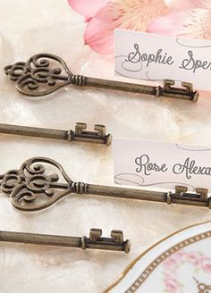 Vintage charm meets utterly unique in this Victorian key that holds place cards and photos. A fabulous favor is the key to a memorable thank-you gift and this intricately crafted key is designed to unlock memories!