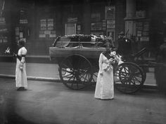 Mrs Yates and Mary Lee guard the coffin of the English suffragette Emily Davison at Victoria Station, London. Davison died after throwing herself under the King's horse during the Derby