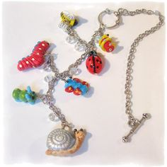 This handmade Bugs Life Car Charm for rear view mirror features 7various bug beads, 7 clear faceted rondelle beads and silvertone chain with toggle