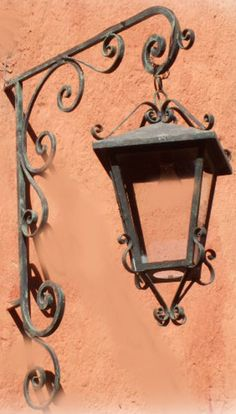 This Rustica House colonial outdoor wall lantern was produced of hammered iron. The lantern is available with oxidized finishing, unfinished or painted black. Rustic Wall Lighting, Rustic Light Fixtures, Antique Lighting, Outdoor Wall Lantern, Outdoor Walls, Lamp Post Lights, Wall Lights, Colonial, Steel Art