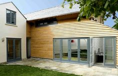Timber casement cottage windows in grey with tongue and groove cladding / render
